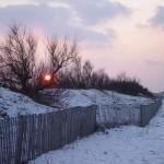 Coucher de soleil dunes enneigées et mer